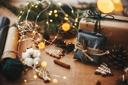 Stylish rustic christmas gift in black wrapping paper