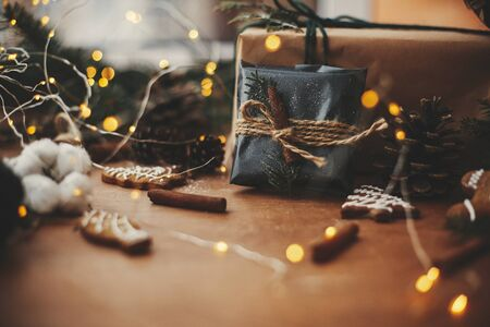 Stylish rustic christmas gift in black wrapping paper with cinnamon decoration Stok Fotoğraf