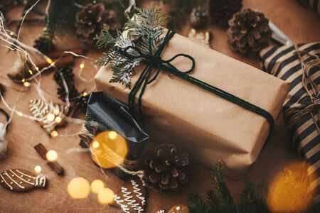Merry Christmas. Stylish rustic christmas gifts with cedar branches and cinnamon decoration