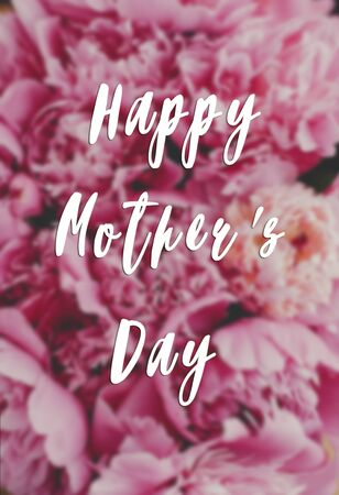 Happy Mothers day text, greeting card. Blurred Beautiful peonies background. Stylish pink peony wallpaper, vertical image. Stock fotó