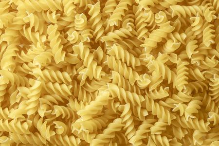 Macaroni close up. Macaroni background. Yellow food background. Macaroni texture