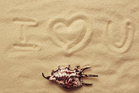 inscription on sand. I love you