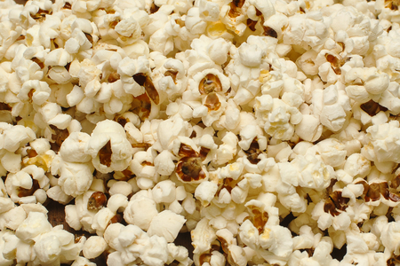 Popcorn close up. Popcorn background. Yellow food background. Popcorn texture