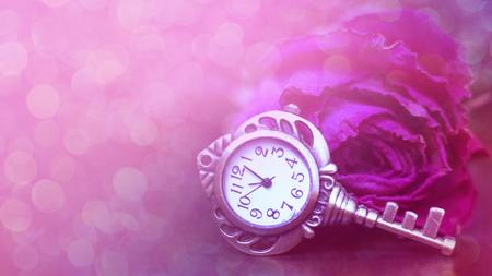 Roses, a pocket watch and old key. Vintage Wonderland background. Soft selective focus toning