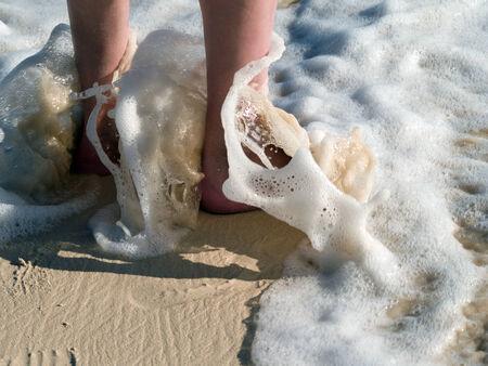feet in the water at the beach of bavarobeach photo