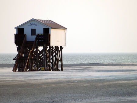 yachtsman: stilt houses on the beach in santa peter ording