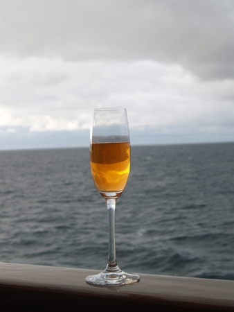 half full: half full - half empty glass in front of the horizon Stock Photo