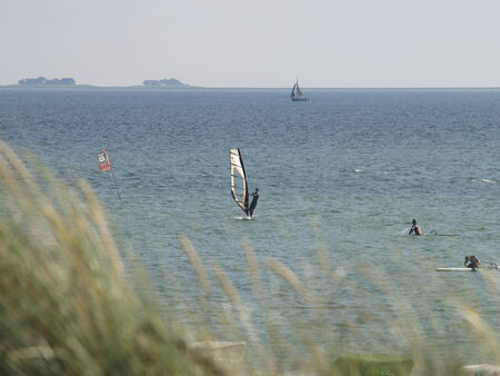 kiter: kitesurfer on the sea