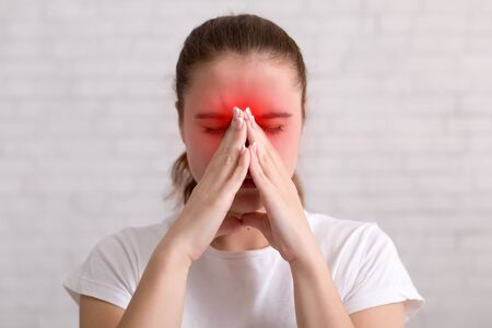 Sick woman suffers from flu and running nose