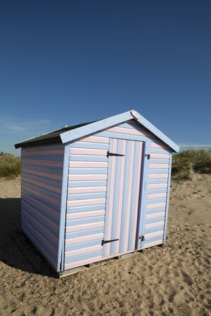Quirky pink and blue striped beach hut  Picture taken on the East coast of England  Stock Photo