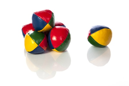 six: Set of six juggling balls  five in a stack and one isolated  Allowing for cropping options and signifies the difficulty of juggling six