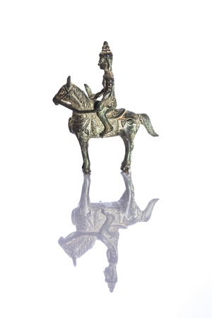 Antique figurine of an ancient dynasty warrior on horseback