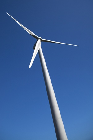 Clean energy wind turbine against a clear blue sky  A simple and effective image with many environmental connotations   Stock Photo