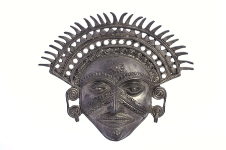 peruvian culture: Ornate metal Inca Sun God mask isolated against white background Stock Photo