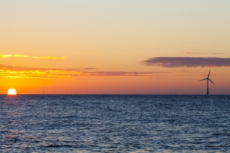 Offshore wind turbine at sunrise  Picture taken off the coast of East Anglia, UK