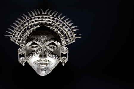 imposing: Dramatic Sun God mask  The lighting of this shot emphasises the imposing nature of the subject   Stock Photo