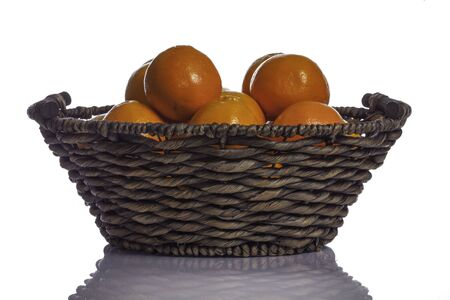 Traditional woven basket full of juicy oranges