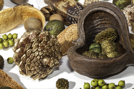 Close up of a sprayed gold pine cone and various seasonal Christmas potpourri items Stock Photo