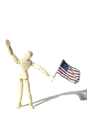 Anonymous American citizen waving a USA flag, Represented by a faceless artist mannequin doll. Connotations of citizenship and illegal immigration etc. Shot against a white background with shadow and provinding text space.