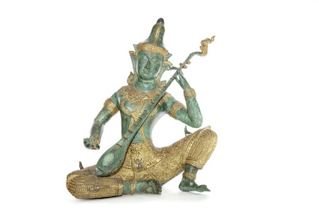 Traditional Buddhist Thai musician cast in typical green and gold bronze
