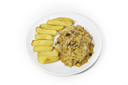 East meets West Curry and Chips. Chicken Korma with vegetables and sultanas, served with chunky chips. Isolated against a white background.