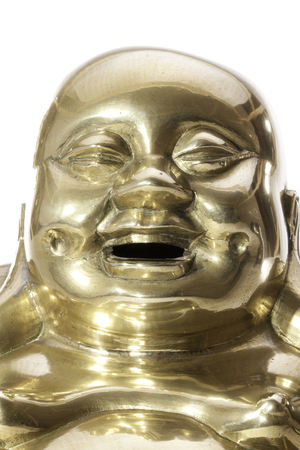 Jolly laughing Buddhist monk face, Close up of a traditional brass laughing monk Buddha.