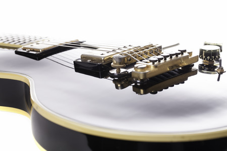 intonation: Iconic rock black and gold rock guitar. A classic musical instrument that has become a status symbol.