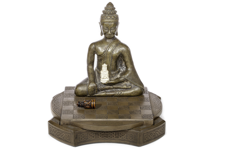 Zen chess master. A buddha figure resides over the defeat of black. Spiritual and gaming connotations!