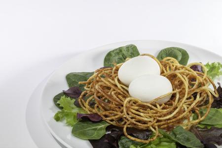 spiralized: Healthy free range hens egg salad with spiralized potato nest. Stock Photo