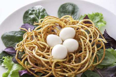 spiralized: Boiled quail eggs in a spiralized fried potato french fries nest, Served with baby leaf salad. Healthy low calorie slimmer�s meal made with a spiralizer.