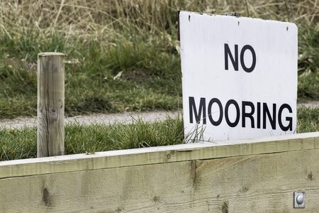 No mooring sign by a mooring point at the side of a river