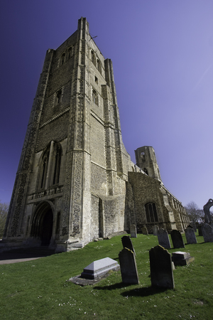 Wymondham abbey cemetery. Ancient Norman religious building. Church with graveyard headstones, from Norfolk in the UK.