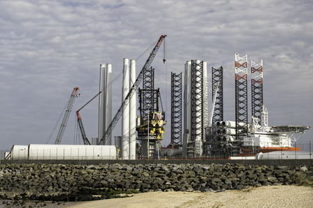 Port supplying turbine parts for offshore wind farm construction. Green renewable energy investment at the Great Yarmouth outer harbour Norfolk, UK.