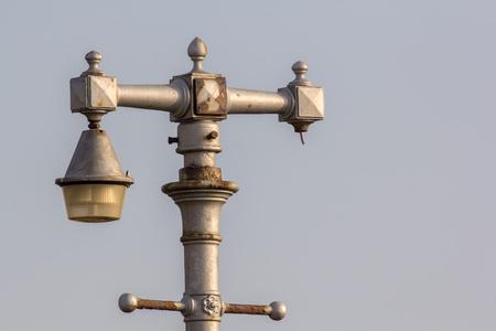 Vintage ornamental street light. Broken antique lamp post. Stock Photo