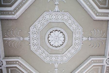 Ornate plaster ceiling decoration. Classical decorative plasterwork. Stock Photo