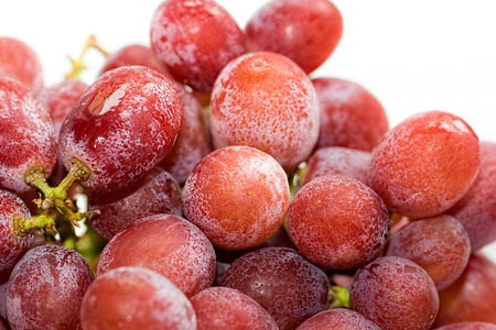 icey: Ice cold red grapes. Organic food ingredient ready for making a healthy fruit smoothie. Nutritional refreshing summer drink preparation.