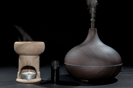 Aromatherapy. Traditional and modern oil burner and aroma diffuser working with essential oil bottle. Image comparing methods.