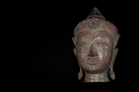 Contemporary Buddhism. High contrast image of metallic buddha head. Spiritual lifestyle of the future represented in this modern new age graphic from photograph.