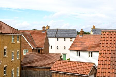 Suburbia. Houses on a modern suburban housing estate. Town living in various residential buildings. Stock Photo