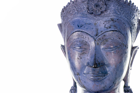 Buddha face against white background. Modern contemporary purple blue zen buddhism statue. Buddhist carving.