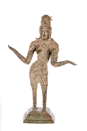 Traditional antique bronze statue of Lakshmi Hindu Goddess of wealth prosperity and fortune. Full figure isolated against white background. Stock Photo