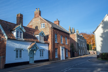 Town houses in typical English village street. Wymondham UK. Pretty market town in Norfolk, England. Imagens
