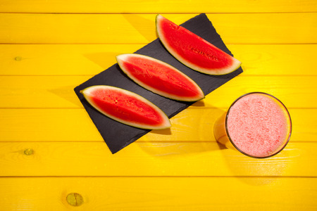Pink frothy watermelon juice drink. Cool refreshing summer fruit smoothie. Colorful vibrant hot weather image. Stock Photo