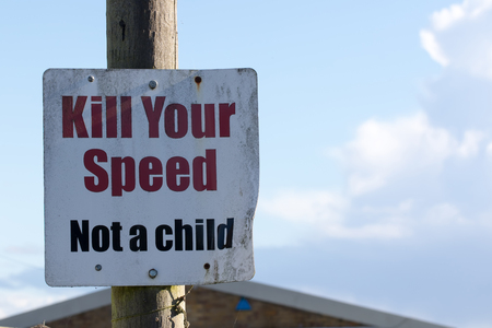 Kill your speed not a child road sign. School safety traffic calming notice. Written warning to drivers near children for accident prevention.
