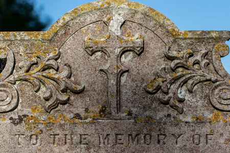 Genealogy and ancestry. Old religious graveyard headstone to the memory of ancient ancestor relatives. English cemetery close-up of a stone memorial. 版權商用圖片