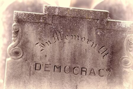 In Memory of democracy. Brexit referendum and election concept image. Gravestone with the word democracy. Political madness and modern politics gone bad.