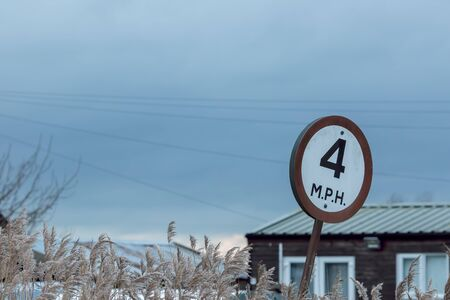 Low rural speed limit sign. 4 M.P.H. slow road speed limit. Norfolk UK.