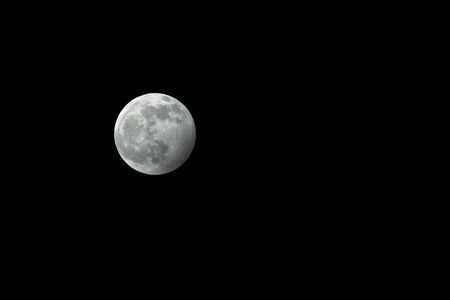 Wolf Moon. First full moon of 2020. January 10th UK also a penumbral lunar eclipse. Isolated on natural black night sky. For cut out etc. Archivio Fotografico