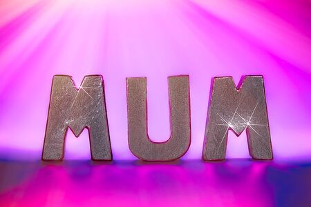 Mums the word under party pink disco lighting. Silver metallic text letters spelling MUM with sparkle and purple graduated background. Pretty feminine mothers day, birthday card or anniversary image