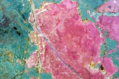 Rhodonite pink massive. Close-up of manganese inosilicate marble surface. Natural crystalline mineral deposit. Beautiful organic background image of this patterned heart chakra stone. Abstract pattern Archivio Fotografico